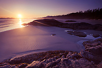 Beautiful sunset scenery of Pacific Rim National Park, Long Beach at Green Point at low tide. Pacific ocean shore in Tofino, Vancouver Island, BC, Canada.