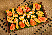 Bananas, papaya and oranges on fruit tray at Bulou's Eco Lodge, Navala Village, Viti Levu Island, Fiji.