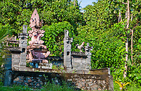 Rural Hindu temple with rooster in a valley near Amed, Bali, Indonesia