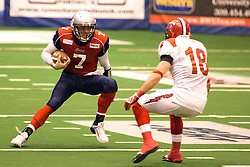 14 March 2009:Mitch Tanney looks for the lane up field and a way around Matt Lein on a quarterback keeper play. The Sioux Falls Storm were hosted by the Bloomington Extreme in the US Cellular Coliseum in downtown Bloomington Illinois.