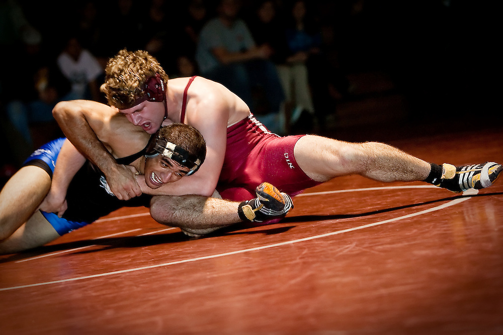 JEROME A. POLLOS/Press..North Idaho College's Rudi Burtschi stretches out and tightens his grip on Ali Al-Rekabi Jr., from Simon Fraser University, during the 197-pound match Friday.
