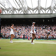 LONDON, ENGLAND - JULY 15:  Garbine Muguruza of Spain with the winners trophy and Venus Williams of The United States leave Center Court after the Ladies Singles Final during the Wimbledon Lawn Tennis Championships at the All England Lawn Tennis and Croquet Club at Wimbledon on July 15, 2017 in London, England. (Photo by Tim Clayton/Corbis via Getty Images)