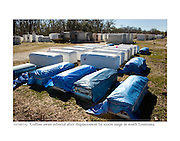 12/26/05:  Coffins await reburial after displacement by storm surge in south Louisiana.