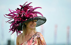 © licensed to London News Pictures. LONDON, UK.  28/07/11. A woman wears a hat with pink feathers. Ladies day at Glorious Goodwood on 28 July 2011. More than 100,000 people flock through the gates of Glorious Goodwood to enjoy the atmosphere. There are racing highlights every day - including the Sussex Stakes, the Goodwood Cup and the Markel International Nassau Stakes.Mandatory Credit Stephen Simpson/LNP