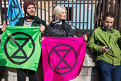 London, UK. 3 May, 2019. Climate change activists from Extinction Rebellion Youth lock onto the railings surrounding the Houses of Parliament in Parliament Square to call for urgent action from the British government to combat climate change, expressing disappointment regarding the outcome of talks between Extinction Rebellion representatives and Secretary of State for the Environment Michael Gove.