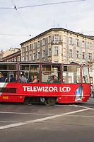 Red tram passes through Podgorze Krakow Poland