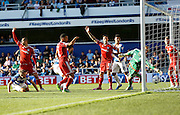 Simon Moore can't stop QPR's second crossing the line despite his best efforts during the Sky Bet Championship match between Queens Park Rangers and Cardiff City at the Loftus Road Stadium, London, England on 15 August 2015. Photo by Andy Walter.