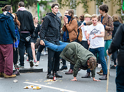 © Licensed to London News Pictures. 01/05/2017. Oxford, UK. A group of young men messing about as Oxford University students and members of the public celebrate May Day in the early hours of the morning near Magdalen Bridge in Oxford, Oxfordshire. Students were again prevented from jumping from the bridge in tot he water, which has historically been a tradition, due to injuries at a previous years event . Photo credit: Ben Cawthra/LNP
