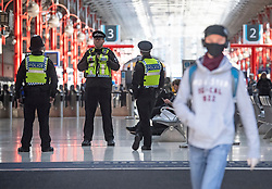 © Licensed to London News Pictures. 18/05/2020. London, UK. Large police presence at Waterloo station in London during lockdown. Government has announced a series of measures to slowly ease lockdown, which was introduced to fight the spread of the COVID-19 strain of coronavirus. Photo credit: Ben Cawthra/LNP