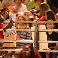Adam Robison | BUY AT PHOTOS.DJOURNAL.COM<br /> A young Corinth fan takes it easy as he watches the game from the edge of the stands Friday ngith as Corinth hosted Kossuth.