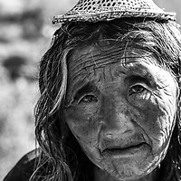 A poor lady selling her wares in the Bhutanese country side.