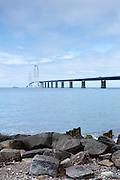 The Great Belt Bridge suspension bridge over Storebaelt joins Funen to Zealand view from Halskov rocks, Denmark