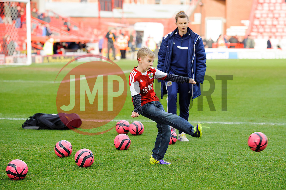 Children take part in a half time competition - Photo mandatory by-line: Rogan Thomson/JMP - 07966 386802 - 01/03/2014 - SPORT - FOOTBALL - Ashton Gate, Bristol - Bristol City v Gillingham - Sky Bet League One.