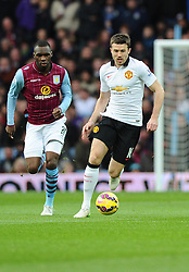 Manchester United's Michael Carrick brings the ball out of defence  - Photo mandatory by-line: Joe Meredith/JMP - Mobile: 07966 386802 - 20/12/2014 - SPORT - football - Birmingham - Villa Park - Aston Villa v Manchester United - Barclays Premier League