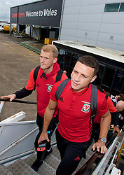 CARDIFF, WALES - Monday, September 4, 2017: Wales' James Chester [R] and goalkeeper Adam Davies [L] boards the team plane as the squad depart Cardiff Airport to travel to Chișinău ahead of the 2018 FIFA World Cup Qualifying Group D match against Moldova. (Pic by David Rawcliffe/Propaganda)