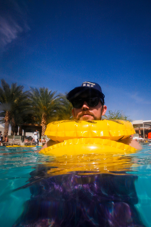 Nick Paradowski of Los Angeles poses for a portrait while wearing two inner tubes in the pool during the Desert Gold 2014 pool party at the ACE Hotel & Swim Club, Coachella weekend on Saturday, April 19, 2014 in Palm Springs, California.© 2014 Patrick T. Fallon, No Use Without Permission