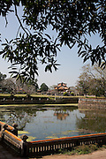 Reconstructed pagoda viewed across the lake in the Forbidden Purple City, Hue Citadel / Imperial City, Hue, Vietnam