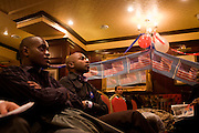 African-Americans take in latest news as Barack Obama is declared winner of another US state during election night in London