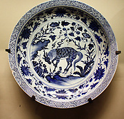 Dish with under glaze blue decoration of a kylin horned creature, Jingdezhen kilns, Jangxi province, 1350-1400.