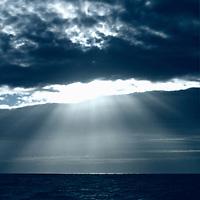 Dramatic lightrays through ocean clouds.