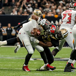 Nov 5, 2017; New Orleans, LA, USA; New Orleans Saints defensive end Alex Okafor (57) sacks Tampa Bay Buccaneers quarterback Jameis Winston (3) during the first half of a game at the Mercedes-Benz Superdome. Mandatory Credit: Derick E. Hingle-USA TODAY Sports