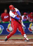 MEXICO CITY - MARCH 10: Left fielder Frederich Cepeda #24 of Cuba takes a swing at a pitch with a runner on third base during the Pool B, game four against Australia in the first round of the 2009 World Baseball Classic at Foro Sol Stadium in Mexico City, Mexico, Tuesday March 10, 2009. Cuba defeated Australia 5-4. (Photo by Paul Spinelli/WBCI/MLB Photos) *** Local Caption *** Frederich Cepeda
