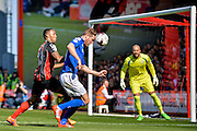 Michael Morrison beats Callum Wilson to the ball during the Sky Bet Championship match between Bournemouth and Birmingham City at the Goldsands Stadium, Bournemouth, England on 6 April 2015. Photo by Adam Rivers.