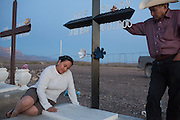 Lilia Falcón, left, visits the grave of her father José with her uncle Carmen Rico, right, at a family cemetery in Boquillas del Carmen on May 14, 2014. Rico has lived in Midland, Texas for several decades and visited Boquillas for the first time since his brother's death in 2000, unable to cross the border from 2002 until 2013.