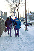 Homeless men age 50 walking in the dead of winter.  St Paul Minnesota USA