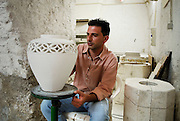 Gerace, a perfectly preserved medieval town once home to 128 churches. Traditional pottery.