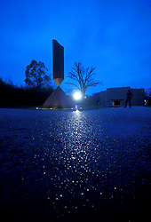Stock photo of Barnett Newman's sculpture, Broken Obelisk at night at the Rothko Chapel in Houston Texas