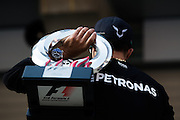 April 10-12, 2015: Chinese Grand Prix - Lewis Hamilton (GBR), Mercedes carries his trophy from the Chinese Grand Prix