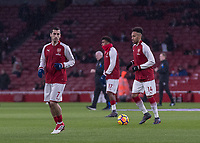 Football - 2017 / 2018 Premier League - Arsenal vs. Everton<br /> <br /> Arsenal new signings Henrikh Mikhitaryan (Arsenal FC) and Pierre-Emerick Aubameyang (Arsenal FC) warm up ahead of making their debuts at The Emirates.<br /> <br /> COLORSPORT/DANIEL BEARHAM