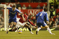 Photo: Aidan Ellis.<br /> Manchester United v Chelsea. The Barclays Premiership. 26/11/2006.<br /> United's Louis Saha is caught by Chelsea's John Terry as Ricardo Carvallho looks on