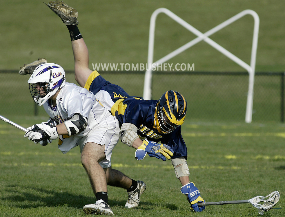 Pine Bush's Alex Vessely, right, falls over Warwick's Armand Rivera during a game in Warwick on Friday, April 15, 2011.