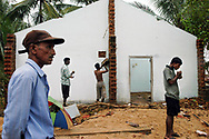Victims of the December 26, 2004 Tsunami begin to return to their devastated homes from displaced person's camps to start the process of clearing away the debris and picking up the pieces of their lives. Batticaloa, Sri Lanka. 11/01/2005. Photo © J.B. Russell