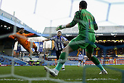 Wolverhampton Wanderers midfielder Nathan Byrne  tries to beat Sheffield Wednesday goalkeeper Keiren Westwood  during the Sky Bet Championship match between Sheffield Wednesday and Wolverhampton Wanderers at Hillsborough, Sheffield, England on 20 December 2015. Photo by Simon Davies.