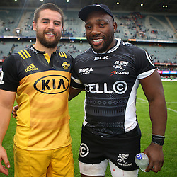 DURBAN, SOUTH AFRICA - MAY 07: Dane Coles (c) of the Hurricanes with Tendai Mtawarira (captain) of the Cell C Sharks during the Super Rugby match between Cell C Sharks and Hurricanes at Growthpoint Kings Park on May 07, 2016 in Durban, South Africa. (Photo by Steve Haag /Gallo Images)