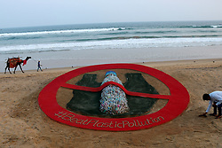 October 1, 2018 - Bhubaneswar, Odisha, India - An awareness sand art about stop plastic use is seen at the Bay of Bengal Sea's eastern coast beach, creating by Indian sand artist Sudarshan Pattnaik to spread out the message all over the World at Puri, 65 km away from the eastern Indian state Odisha's capital city Bhubaneswar on 2 October 2018. (Credit Image: © Str/NurPhoto/ZUMA Press)
