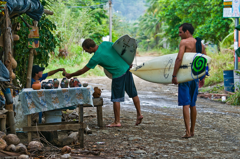 Bryson and Hugh chat with a local vendor  in Dominical, Costa Rica