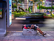 "30 MARCH 2013 - BANGKOK, THAILAND:  A man sleeps on a concrete block on Sukhumvit Road in Bangkok. Thailand's economic expansion since the 1970 has dramatically reduced both the amount of poverty and the severity of poverty in Thailand. At the same time, the gap between the very rich in Thailand and the very poor has grown so that income disparity is greater now than it was in 1970. Thailand scores .42 on the ""Ginni Index"" which measures income disparity on a scale of 0 (perfect income equality) to 1 (absolute inequality in which one person owns everything). Sweden has the best Ginni score (.23), Thailand's score is slightly better than the US score of .45.  PHOTO BY JACK KURTZ"