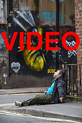 VIDEO AVAILABLE HERE: https://we.tl/4As1auVP06<br /> <br /> © Licensed to London News Pictures . 06/04/2017 . Manchester , UK . A man appears disorientated and is incoherent as he sits forward on the pavement on Newton Street . An epidemic of abuse of the drug spice by some of Manchester's homeless population , in plain sight , is causing users to experience psychosis and a zombie-like state and is daily being witnessed in the Piccadilly Gardens area of Manchester , drawing large resource from paramedic services in the city centre . Photo credit : Joel Goodman/LNP