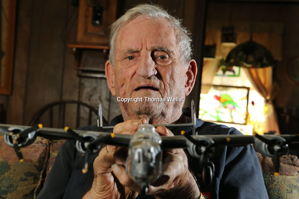 Wallace Crumby of Tupelo holds a model of a B-24 Liberator similiar to the one he nad his twin brother flew 35 missions in as part of the 8th Air Force during WWII.