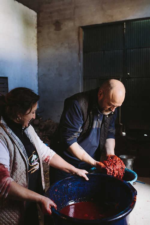 Food writer Tim Hayward mixes blood into the filling for Morçilla, Finca Al Cornocal, Extramadura (Barajoz Province), Spain.