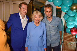 Left to right, Tom Parker Bowles, HRH The Duchess of Cornwall and Richard Bacon at the launch of the Fortnum & Mason Christmas & Other Winter Feasts Cook Book by Tom Parker Bowles held at Fortnum & Mason, 181 Piccadilly, London, England. 17 October 2018.
