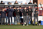 26th December 2017, Dens Park, Dundee, Scotland; Scottish Premier League football, Dundee versus Celtic; Dundee manager Neil McCann and Dundee bench during applause for McCann's father, Eddie, who passed away at the weekend