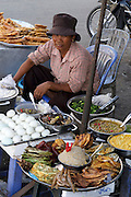 Phnom Penh, Cambodia. Street vendors and food stalls.
