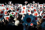 Well-wishers wave a Japanese national flag as Japan's Emperor Akihito (not pictured) appears on a balcony of the Imperial Palace to celebrate his 84th birthday in Tokyo, Japan, December 23, 2017.. 23/12/2017-Tokyo, JAPAN