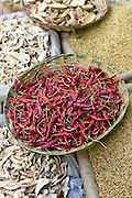 Red chillies and dried mango skins on sale at Khari Baoli spice and dried foods market, Old Delhi, India