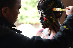 A young man get himself painted in preparation for local Yi people's annual fire worshipping festival, which falls on the third day of the second month in the Chinese lunar calendar at Xiyi Township under Mile City, southwest China's Yunnan Province, March 11, 2016. EXPA Pictures © 2016, PhotoCredit: EXPA/ Photoshot/ Lin Yiguang<br /> <br /> *****ATTENTION - for AUT, SLO, CRO, SRB, BIH, MAZ, SUI only*****